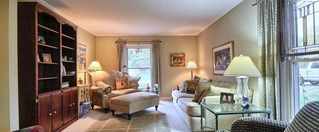 staged living room in Northville Commons home for sale